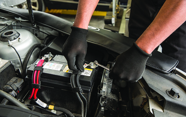 hands on a car battery