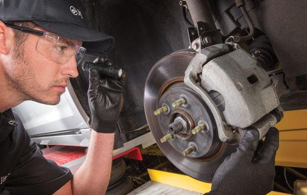 Man Checking Brakes
