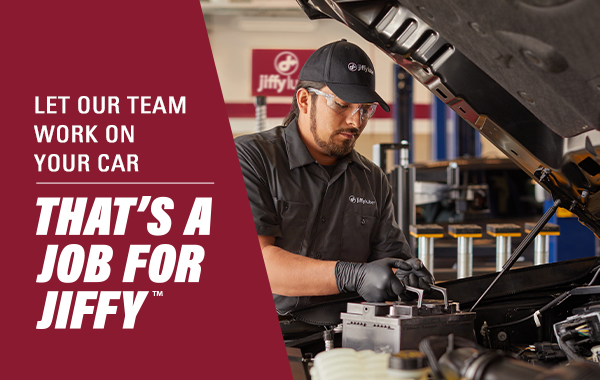 Man working on car engine with text saying That's a Job For Jiffy