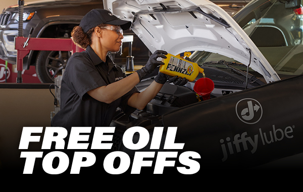woman replenishing car fluids with bottom text that says Free Oil Top Offs