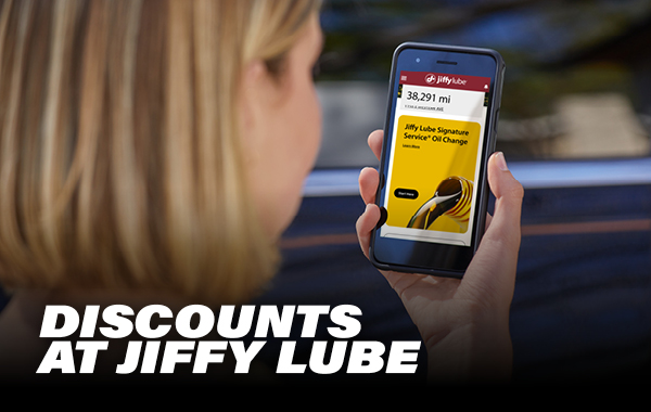 woman looking at jiffy lube coupon on phone with bottom text saying Discounts at Jiffy Lube