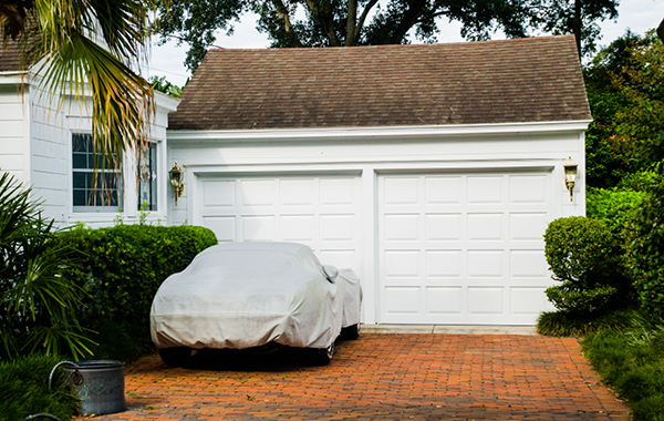 car covered with tarp on driveway